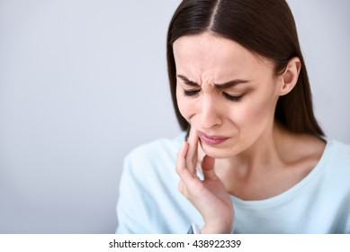 Cheerless woman having toothache