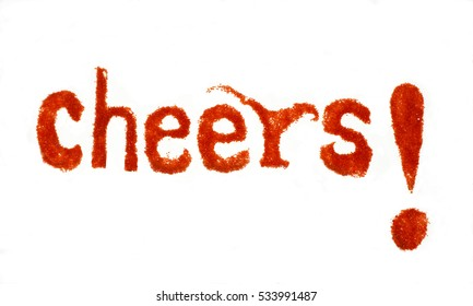 Cheers is a celebration message. Handmade type with red colored sugar.