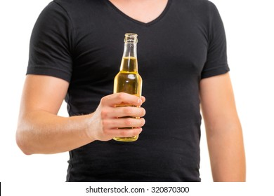 Cheers! Close up of male hand holding bottle of beer. Isolated on white.