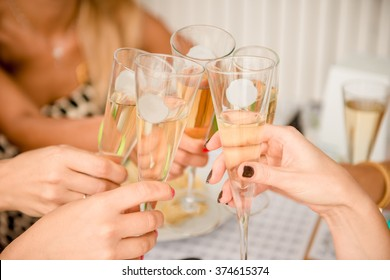 cheers! Close up photo of women clinking  glasses
