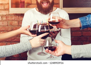Cheers! Close-up of creative business team having toast on colleges birthday at office. Party, holidays, celebration, nightlife and people concept - smiling friends clinking glasses of wine in home