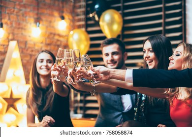 Cheers! Friends with glasses of champagne during party celebration. New year, Birthday, Holiday Event concept