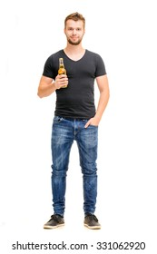 Cheers! Full length studio portrait of handsome young man holding the bottle of beer. Isolated on white.