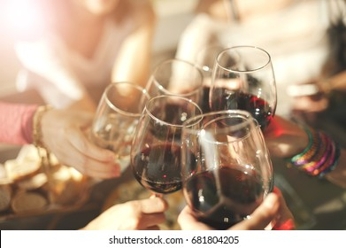 Cheers with glasses of red wine