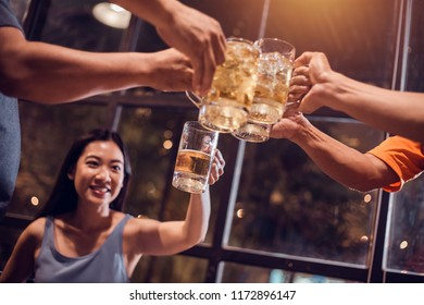 Cheers! Group, Beer mug, Young women brew beer glasses to celebrate their success.
