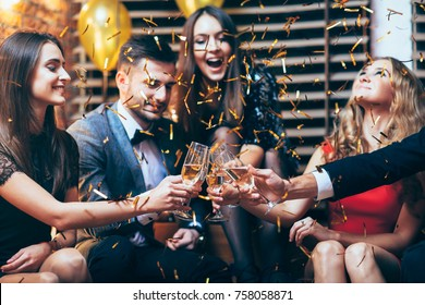 Cheers! Group of friends clinking glasses of champagne during party celebration. New year, Birthday, Holiday Event concept