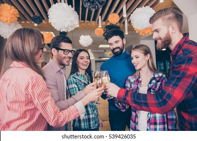 Cheers! six beautiful young happy best friends, boys and girls drink, students laugh and celebrate with champagne and toast