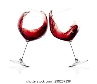 Cheers. A Toast with Red Wine. Splash. Two glasses clicking together over white background. Splashing red wine on balloon glasses