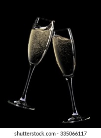 Cheers! Two champagne glasses. Isolated on black background