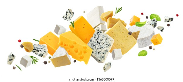 Cheese assortment isolated on white background, different types of cheese flying with herbs and spices, with copy space