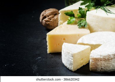 Cheese Assortment on a dark background, selective focus