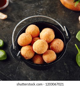 Cheese Balls in Metal Bowler on Dark Background. Heap of Deep Fried Chicken Croquettes Ball on Natural Stone Rustic Backdrop