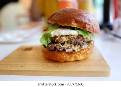 Cheese beef burger. An Angus burger is a hamburger made using beef from Angus cattle. The name Angus burger is used by several fast food hamburger chains for one or more premium burgers.
