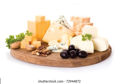 cheese board with delicous cheeses, walnuts and black olives