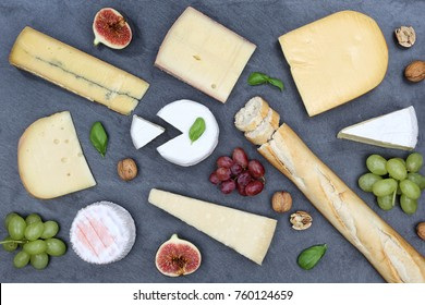 Cheese board platter plate Swiss bread Camembert slate top view from above