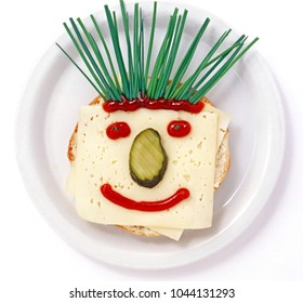 cheese bread face on plate over white background