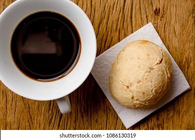 Cheese bread known as Pao de Queijo in Brazil (from Minas Gerais); Chipa in Paraguay; Pandebono in Colombia, Pan de Yuca in Ecuador. Snack and espresso coffee on rustic wood, flat design.