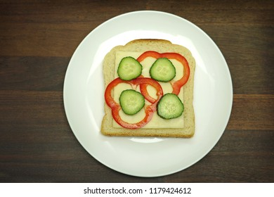 Cheese bread with cheese, red bell pepper and cucumber slices