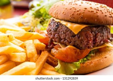 Cheese burger - American cheese burger with fresh salad