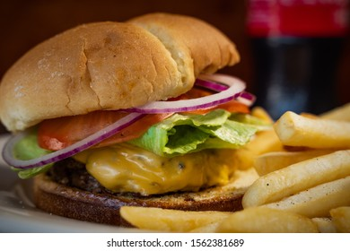 Cheese burger deluxe with French fries