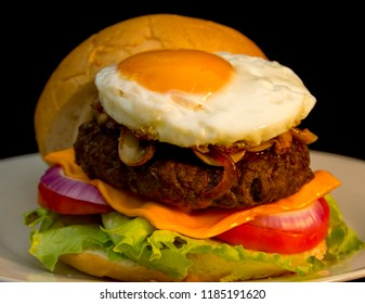 Cheese Burger with Mushrooms, Sauteed Onions, and Sunny Side Egg