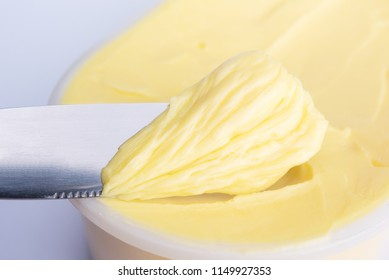 Cheese butter or margarine with knife