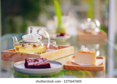 A cheese cake  and  bekery with hot tea for take a break with tea time in the afternoon, daylight sitution.