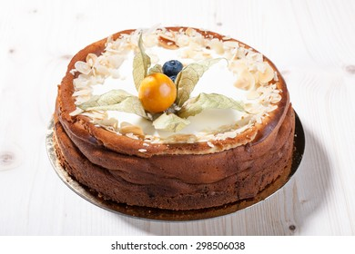 Cheese cake with blueberries on wooden table