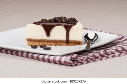 Cheese Cake With Chocolate Sauce On White Plate