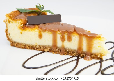 cheese cake decorated with chocolate mint on a white background