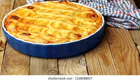 Cheese cake with tangerine.In blue baking tray. Cheese pie.Desert .Homemade.Rustic background.copy space