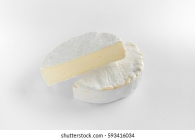 Cheese camembert or brie on white background. Menu design restaurant. Top view design photo. Cheese in white paper. Overhead. Flat view horizontal photo.