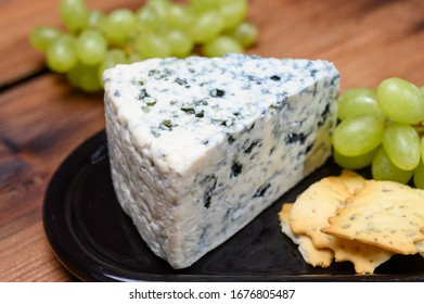 Cheese collection, strong Danish blue cheese Danablu with blue mould close up