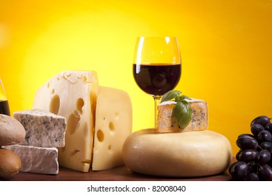 Cheese composition on wooden table