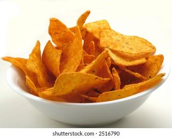Cheese corn chips, nachos, tortillas, in a white bowl on white.