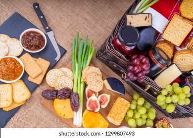 Cheese and Cracker Hamper.  Wicker Hamper full of cheese, crackers with a selection of pickles and fruits.
