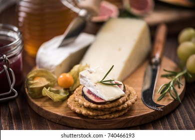 Cheese crackers with camembert,honey,fig and herb. Festive and Christmas food.