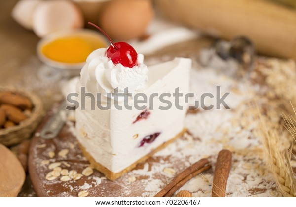 cheese cream cake topping with whipped cream and cherry. cake background concept.