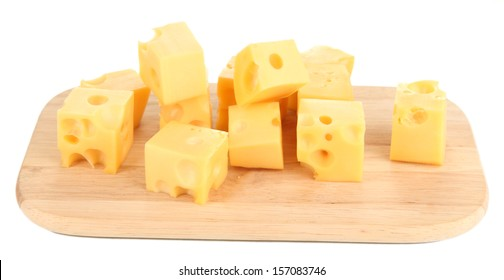 Cheese cubes on wooden board isolated on white