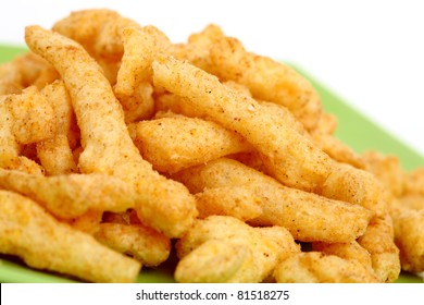 Cheese curls isolated on a white background