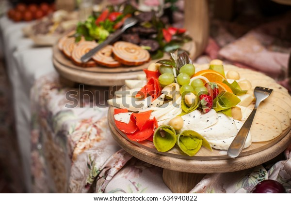 Cheese desk on wedding decorative catering table.
