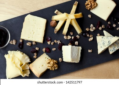 Cheese and dried fruit on a slate dish