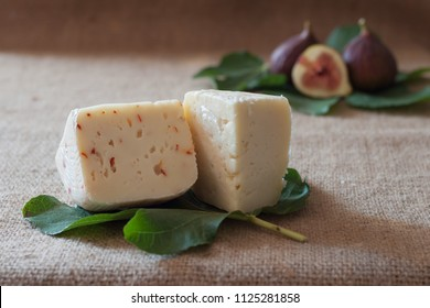 Cheese and figs on fig leaf