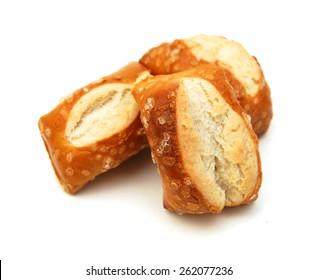 Cheese filled, bite-sized pretzel sticks on white background