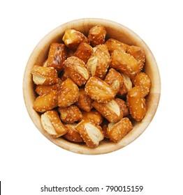 Cheese filled, bite-sized pretzel sticks in wooden bowl on white background