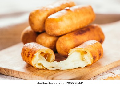 Cheese fingers, typical Venezuelan appetizer called tequeños  on a wooden board