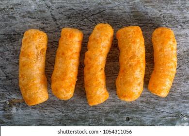 cheese flavored puffed corn snacks