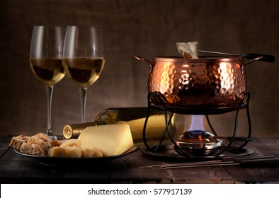 cheese fondue on rustic background