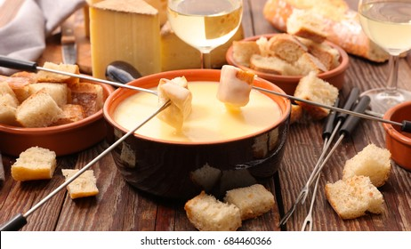 cheese fondue party on wooden table