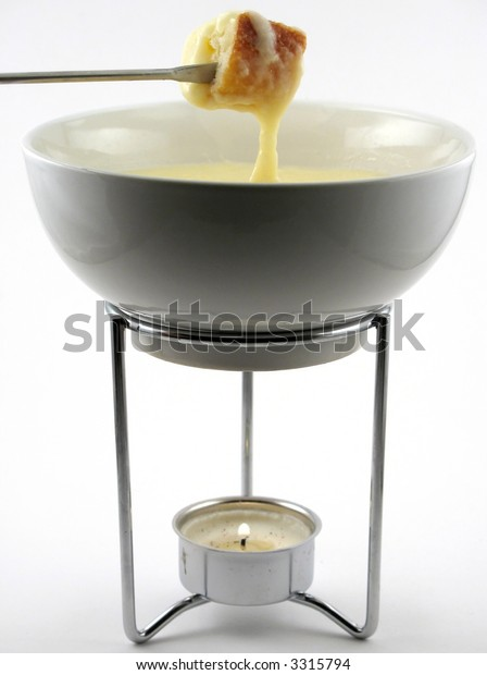 Cheese fondue in a small bowl over a tea light.